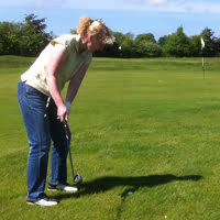 Anne playing golf
